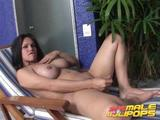Check out delicious brunette shemale Penelope Jolie masturbating her thick cock at the poolside!