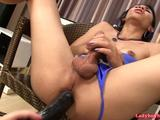 Sexy Thai ladyboy Nin shows off her pretty nice dick and good ass. She starts jerk off and the cameraguy offered her that huge black ...