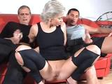 A daring MILF UK nympho takes on 2 hard shafts stretching the vixen's tired cunt & ass--& leaving her pretty face drenched in semen!